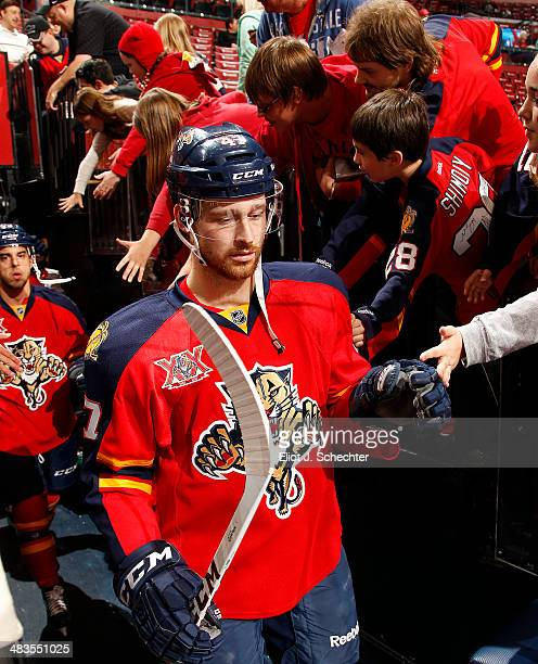 Colby Robak of the Florida Panthers is greeted by fans while heading out to the ice prior to the start of the game against the Calgary Flames at the...
