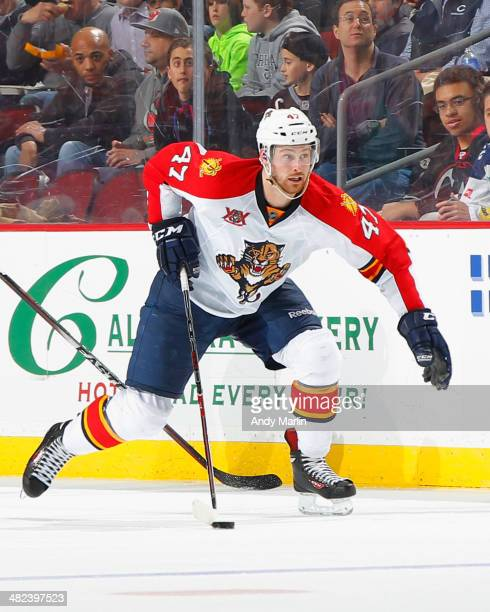 Colby Robak of the Florida Panthers plays the puck against the New Jersey Devils during the game at the Prudential Center on March 31 2014 in Newark...