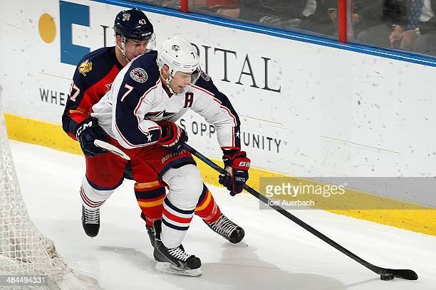 Colby Robak of the Florida Panthers pursues Jack Johnson of the Columbus Blue Jackets as he circles the net with the puck at the BBT Center on April...