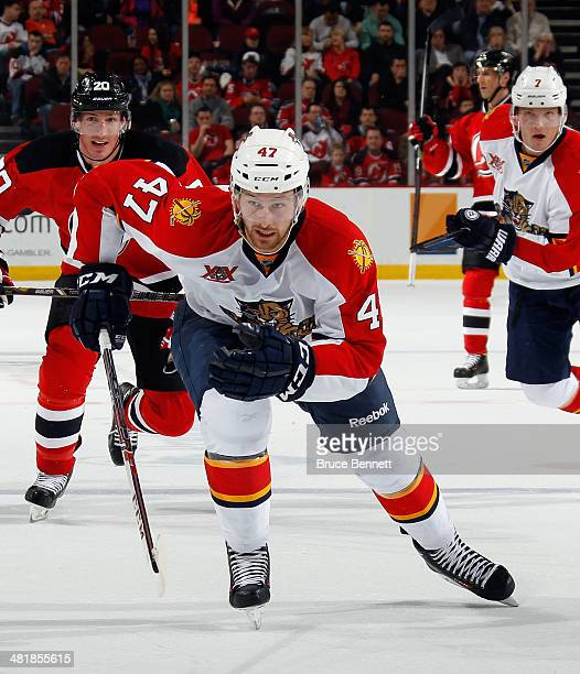 Colby Robak of the Florida Panthers skates against the New Jersey Devils at the Prudential Center on March 31 2014 in Newark New Jersey The Devils...