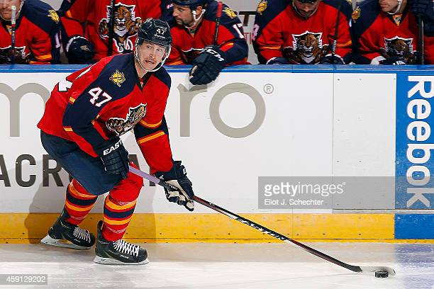 Colby Robak of the Florida Panthers skates with the puck against the New York Islanders at the BBT Center on November 14 2014 in Sunrise Florida