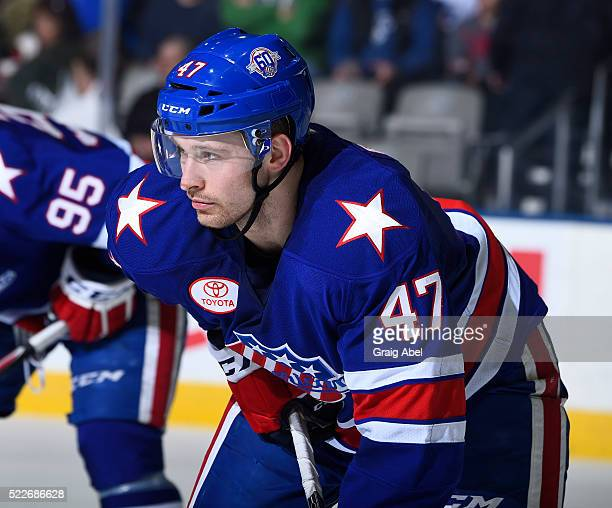 Colby Robak of the Rochester Americans prepares for a faceoff against the Toronto Marlies during AHL game action on April 17 at Ricoh Coliseum in...