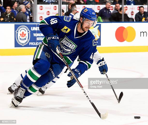 Colby Robak of the Utica Comets controls the puck against the Toronto Marlies during game action on November 26 2016 at Air Canada Centre in Toronto...