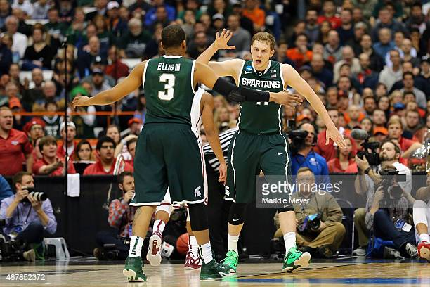 Colby Wollenman of the Michigan State Spartans reacts with teammate Alvin Ellis III after a shot in the first half of the game against the Oklahoma...