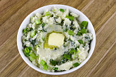A bowl of homemade colcannon topped with a pat of butter