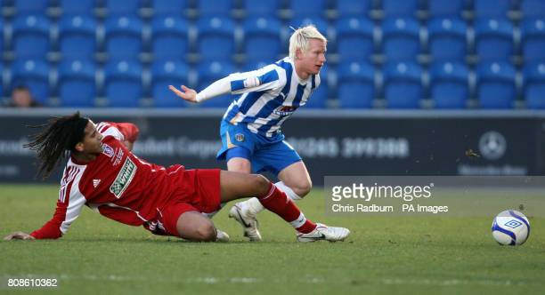 Colchester United's David Perkinds is challenged by Swindon Supermarine's Ashan Holgate during the FA Cup Second Round match at the Weston Homes...
