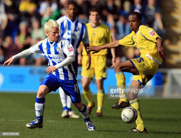 Colchester United's David Perkins and Leeds United's Fabian Delph battle for the ball during the CocaCola League One match at the Weston Homes...