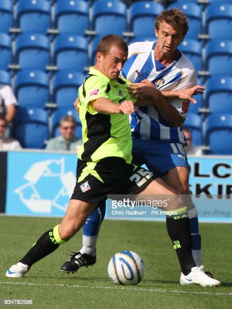 Colchester United's Matt Heath is held off by Lewis Alessandra Oldham's during the CocaCola League One match at the Weston Homes Community Stadium...