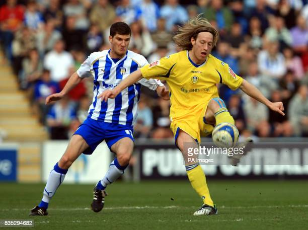 Colchester United's Pat Baldwin and Leeds United's Luciano Becchio battle for the ball during the CocaCola League One match at the Weston Homes...