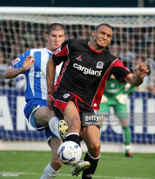 Colchester's Pat Baldwin challenges QPR's Marc Nygaard during the CocaCola Championship match at Layer Road Colchester