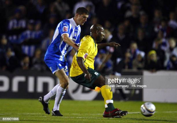 Colchester's Pat Baldwin in action with Plymouth's Barry Hayles during the CocaCola Football Championship match at Layer Road Colchester