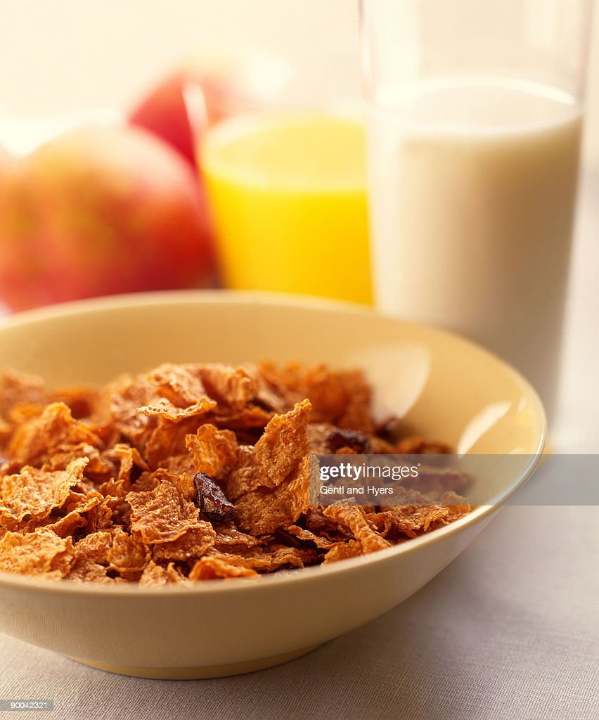 Cold Cereal with raisins in bowl : Stock Photo