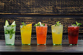 drinks with fruit slices on a wooden background