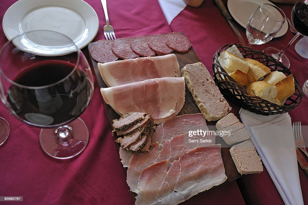 Cold cuts assortment, wine and baguette bread  : Stock Photo