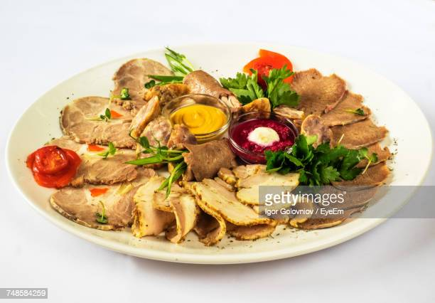 Cold Cuts With Mustard And Horseradish Sauce In Plate Over White Background