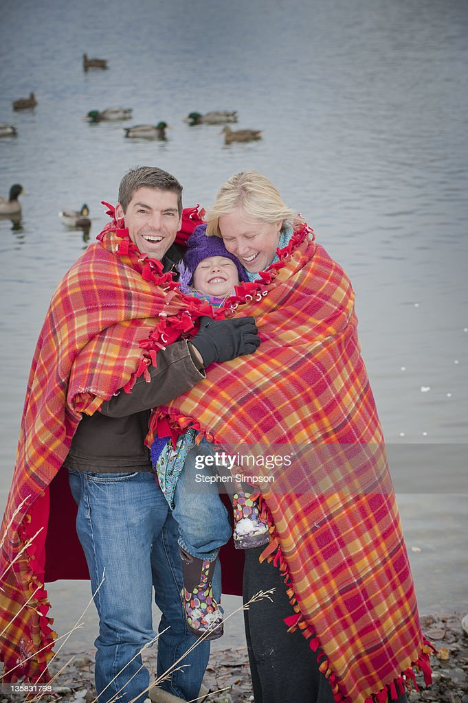cold day, family bundled in a blanket : Stock Photo