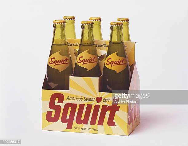 Cold drink in six pack box against white background