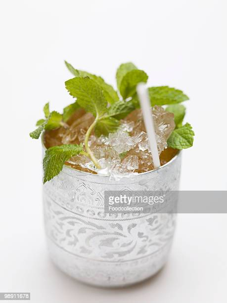 Cold peppermint tea in silver cup, close-up
