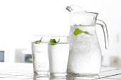 Shoot glasses and cold water in the kitchen at home