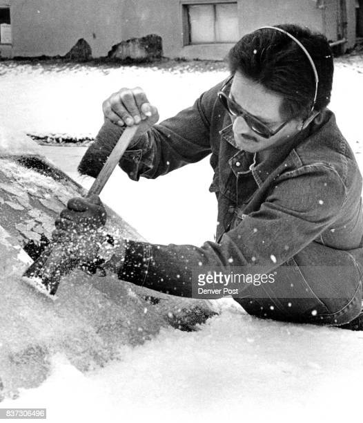 Cold weather art 25th and king John Montour of Denver has to use two hands to scrape the ice off his windshield Credit The Denver Post