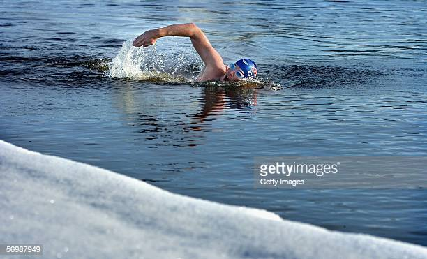 Coldwater swimming sensation Lewis Pugh of Great Britain goes for a training swim in the 0 degree C water of Oulu on March 3 2006 in Oulu Finland...