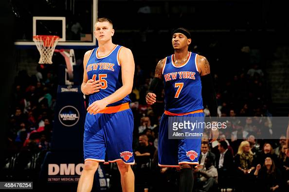 Cole Aldrich and Carmelo Anthony of the New York Knicks stand on the court during a game against the Detroit Pistons on November 5 2014 at The Palace...