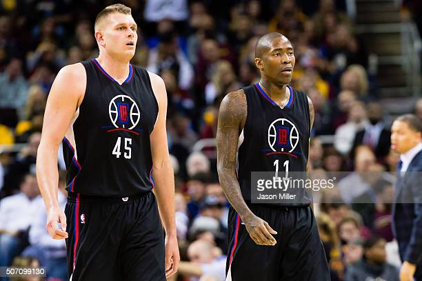 Cole Aldrich and Jamal Crawford of the Los Angeles Clippers pause on the court during the first half against the Cleveland Cavaliers at Quicken Loans...