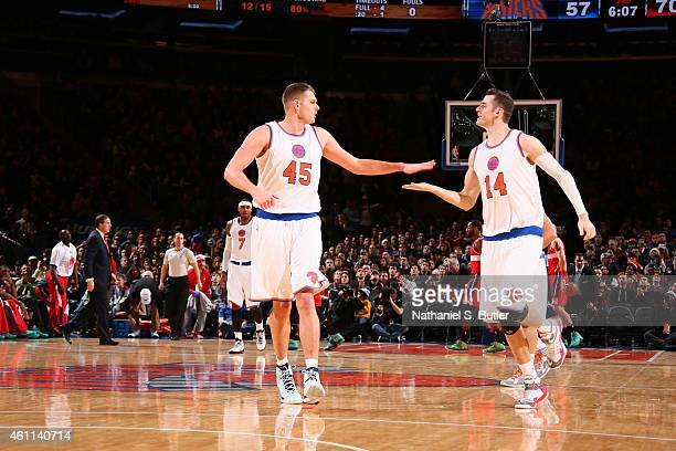 Cole Aldrich and Jason Smith of the New York Knicks celebrate during a game against the Washington Wizards at Madison Square Garden on December 25...