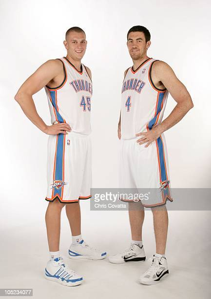 Cole Aldrich and Nick Collison#6 of the Oklahoma City Thunder poses for a portrait during NBA Media Day on September 27 2010 at The Ford Center in...