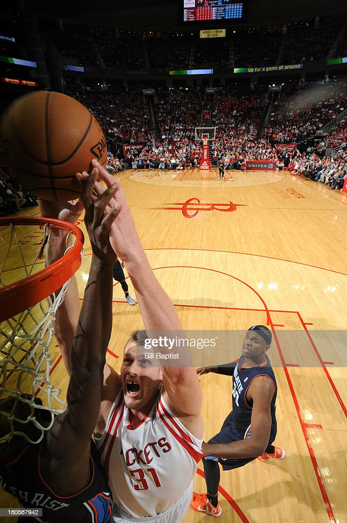 <a gi-track='captionPersonalityLinkClicked' href=/galleries/search?phrase=Cole+Aldrich&family=editorial&specificpeople=4226189 ng-click='$event.stopPropagation()'>Cole Aldrich</a> #31 of the Houston Rockets attempts a dunk against the Charlotte Bobcats on February 2, 2013 at the Toyota Center in Houston, Texas.