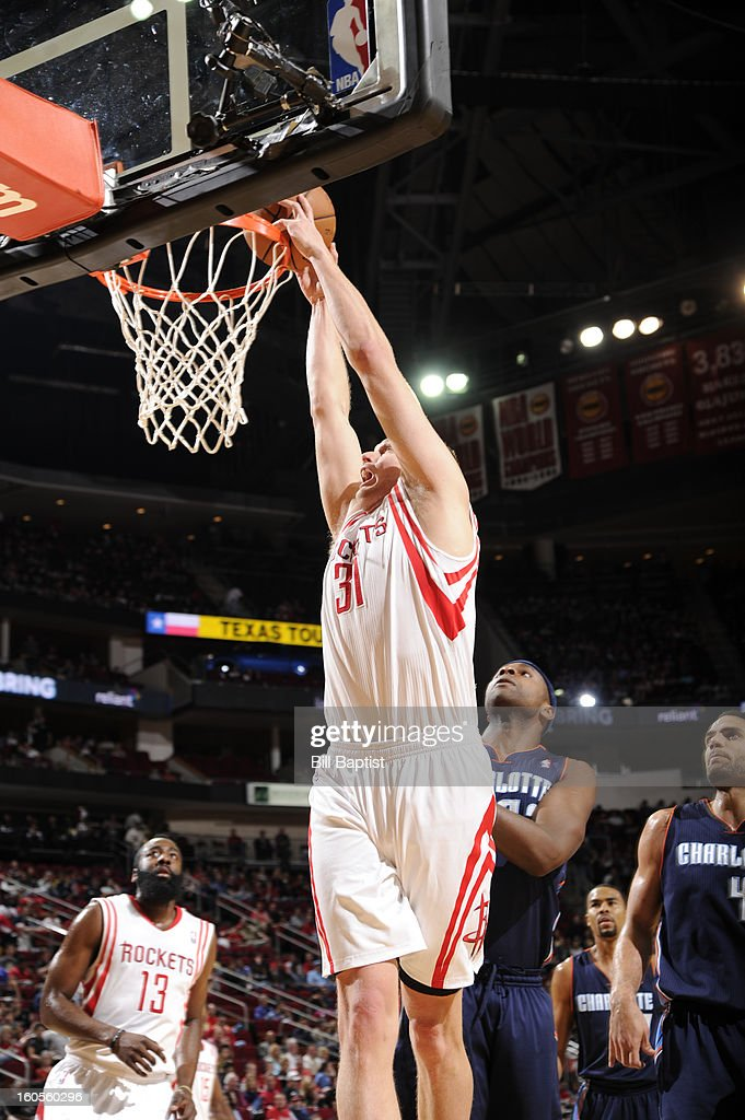Cole Aldrich #31 of the Houston Rockets dunks against the Charlotte Bobcats on February 2, 2013 at the Toyota Center in Houston, Texas.