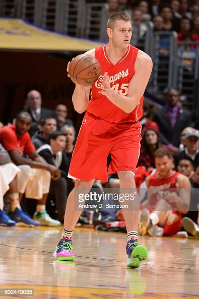 Cole Aldrich of the Los Angeles Clippers controls the ball against the Los Angeles Lakers on December 25 2015 at the Staples Center in Los Angeles...