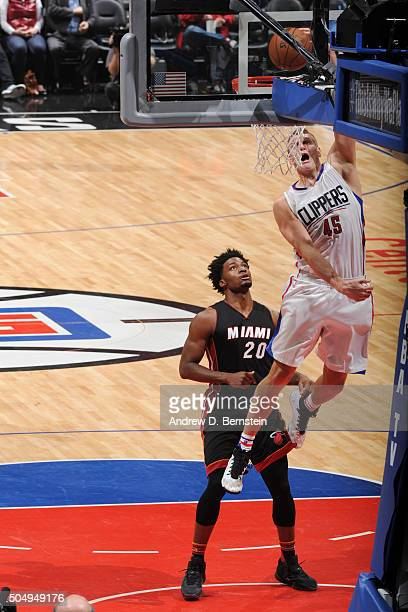 Cole Aldrich of the Los Angeles Clippers goes up for a dunk against the Miami Heat on January 13 2016 at STAPLES Center in Los Angeles California...