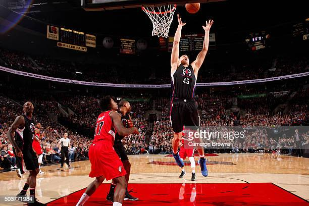 Cole Aldrich of the Los Angeles Clippers grabs the rebound against the Portland Trail Blazers on October 8 2016 at the Moda Center in Portland Oregon...