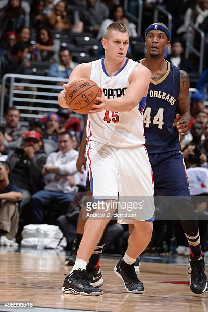 Cole Aldrich of the Los Angeles Clippers handles the ball against Dante Cunningham of the New Orleans Pelicans on November 27 2015 at STAPLES Center...