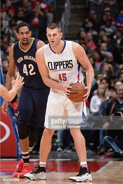 Cole Aldrich of the Los Angeles Clippers handles the ball against the New Orleans Pelicans on January 10 2016 at STAPLES Center in Los Angeles...
