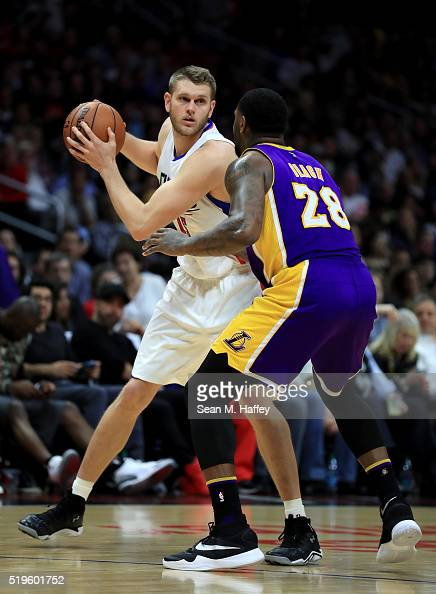 Cole Aldrich of the Los Angeles Clippers looks to pass against Tarik Black of the Los Angeles Lakers during an NBA game between Los Angeles Clippers...