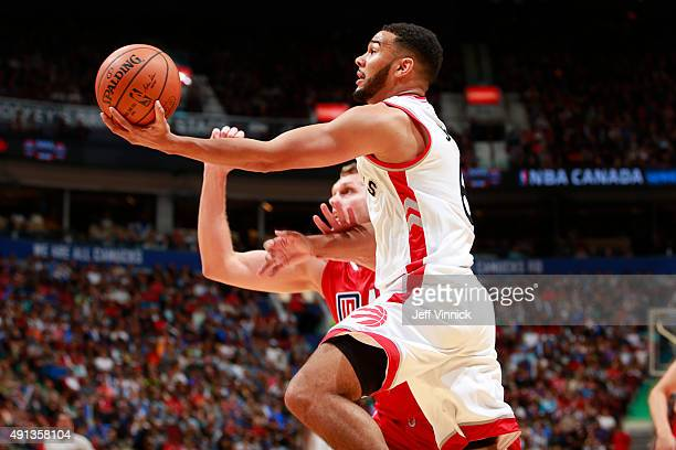 Cole Aldrich of the Los Angeles Clippers reaches out to stop Cory Joseph of the Toronto Raptors as he makes a layup during their NBA preseason game...