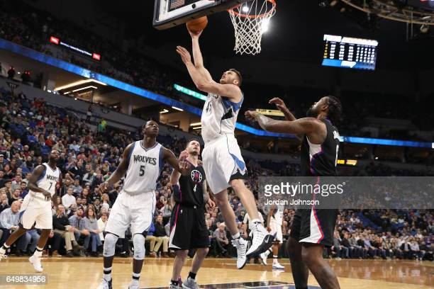 Cole Aldrich of the Minnesota Timberwolves goes up for a lay up against the LA Clippers on March 8 2017 at Target Center in Minneapolis Minnesota...