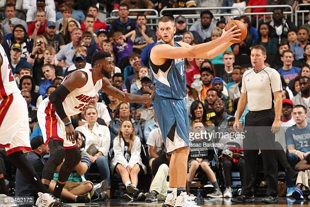 Cole Aldrich of the Minnesota Timberwolves handles the ball against the Miami Heat on October 8 2016 at Sprint Center in Kansas City Missouri NOTE TO...