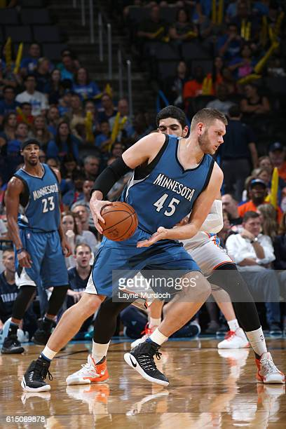 Cole Aldrich of the Minnesota Timberwolves handles the ball against the Oklahoma City Thunder on October 16 2016 at Chesapeake Energy Arena in...