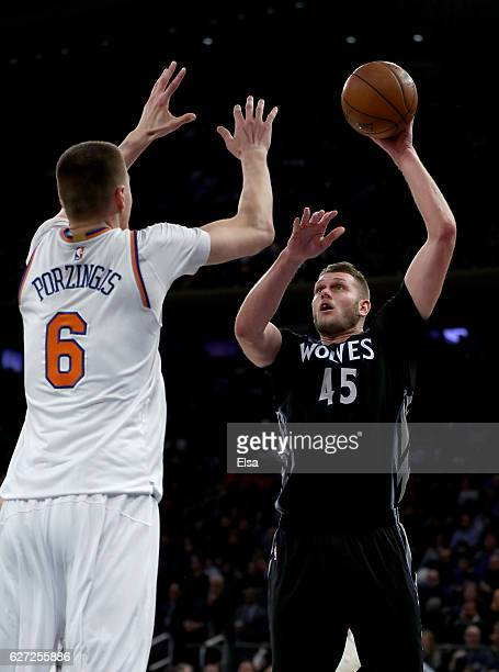Cole Aldrich of the Minnesota Timberwolves heads for the net as Kristaps Porzingis of the New York Knicks defends at Madison Square Garden on...