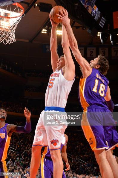 Cole Aldrich of the New York Knicks goes to the basket against Pau Gasol of the Los Angeles Lakers at Madison Square Garden on January 26 2014 in New...