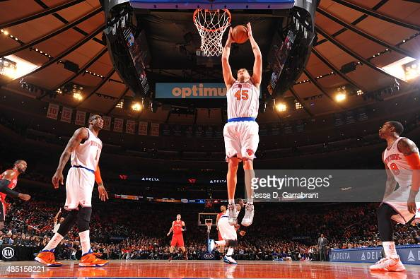 Cole Aldrich of the New York Knicks goes up for the dunk against the Toronto Raptors during the game on April 16 2014 at Madison Square Garden in New...