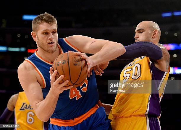Cole Aldrich of the New York Knicks grabs a rebound in front of Robert Sacre of the Los Angeles Lakers at Staples Center on March 25 2014 in Los...