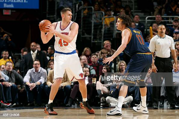 Cole Aldrich of the New York Knicks handles the ball against Anderson Varejao of the Cleveland Cavaliers on October 30 2014 in Cleveland Ohio NOTE TO...