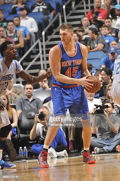Cole Aldrich of the New York Knicks handles the ball against Dewayne Dedmon of the Orlando Magic on April 11 2015 at Amway Center in Orlando Florida...