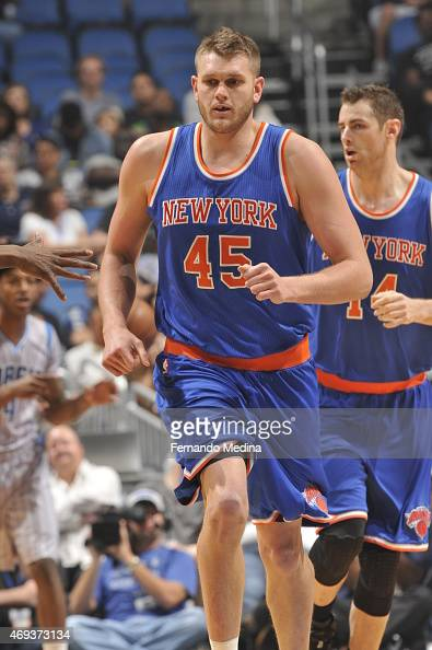 Cole Aldrich of the New York Knicks runs down the court against the Orlando Magic on April 11 2015 at Amway Center in Orlando Florida NOTE TO USER...