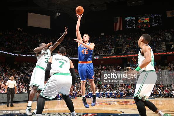 Cole Aldrich of the New York Knicks shoots against the Boston Celtics during a preseason game at the Mohegan Sun Arena on October 11 2014 in...