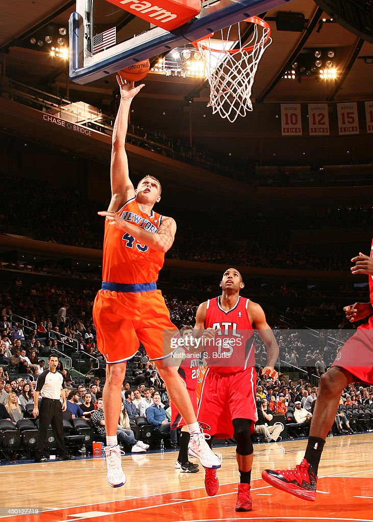 Cole Aldrich #45 of the New York Knicks shoots during a game against the Atlanta Hawks at Madison Square Garden in New York City on November 16, 2013.